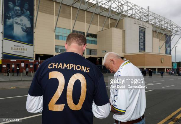 Leeds United fans pose for pictures outside Elland Road during the Sky Bet Championship match between Leeds United and Charlton Athletic at Elland...