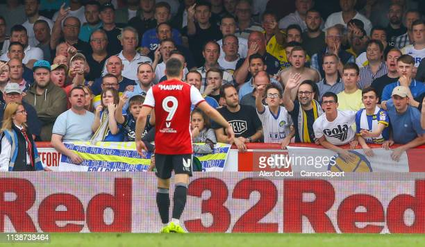Leeds United fans react after Brentford's Neal Maupay taunts them after scoring during the Sky Bet Championship match between Brentford and Leeds...