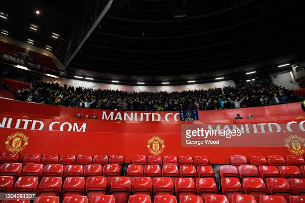 Leeds United fans show their support during the FA Youth Cup Fifth Round match between Manchester United and Leeds United at Old Trafford on February...