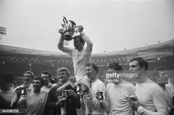 Leeds United FC captain Billy Bremner and fellow soccer players hold trophies after winning the Football League Cup Final against Arsenal FC Webley...