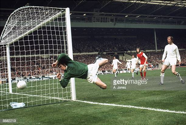 Leeds United FC goalkeeper David Harvey flying through the air after making a save against Arsenal at the Football Association Cup Final
