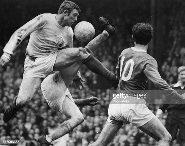 Leeds United football player Mick Jones knocks over Everton goalkeeper Gordon West as he attempts to win the ball during a FA Cup semifinal match at...