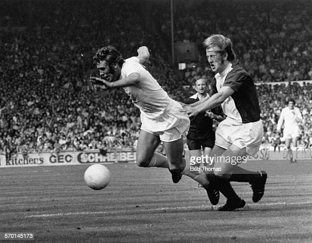 Leeds United football player Mick Jones moves away from Birmingham City's Kenny Burns during a match between the two clubs at Elland Road Leeds...