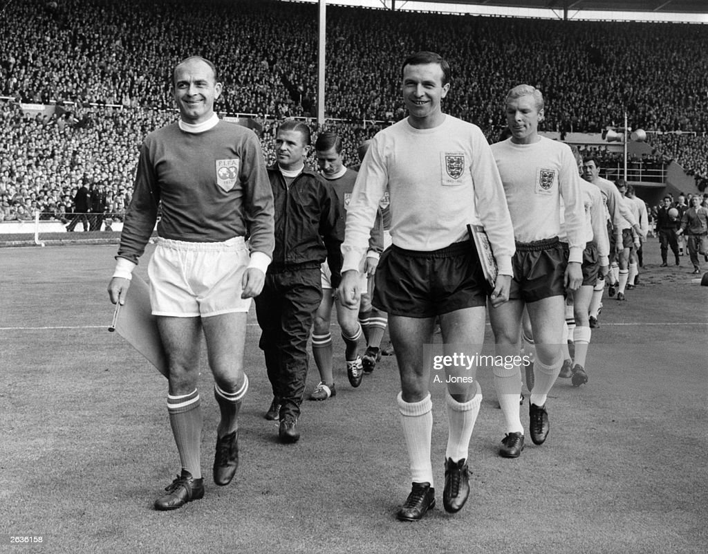 Leeds United footballer Jimmy Armfield (right) leads out the England team as captain, as Alfredo Di Stefano leads out the Rest Of The World Team. They are competing for the FA Centenary Cup. Behind Armfield is Bobby Moore. Di Stefano played internationally for Argentina, Colombia and Spain. Original Publication: HP0174