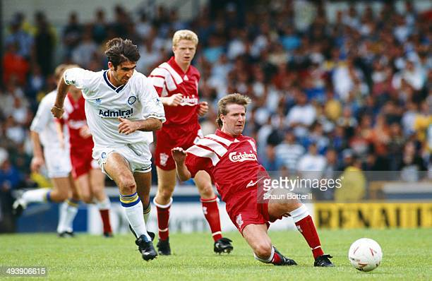 Leeds United forward Eric Cantona is beaten to the ball by Ronnie Whelan during the FA Premier League match between Leeds United and Liverpool at...