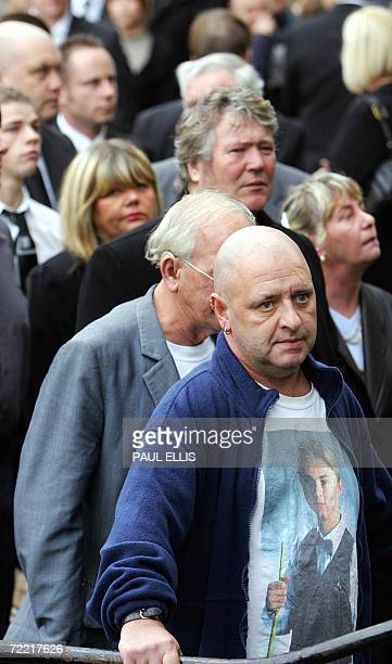 A mourner wearing a shirt with a picture of British snooker player Paul Hunter arrives at his funeral at Leeds Parish Church in Leeds England 19...