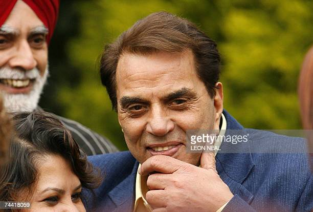 Indian film star Dharmendra Deol visits a family in Leeds 06 June 2007 as part of the promotion of the forthcoming film Apne during the International...