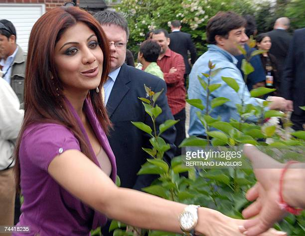 Indian film star Shilpa Shetty shakes hands with fans as she visits a family in Leeds 06 June 2007 as part of the promotion of the forthcoming film...