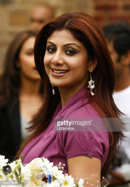 Indian film star Shilpa Shetty visits a family in Leeds 06 June 2007 as part of the promotion of the forthcoming film Apne during the International...