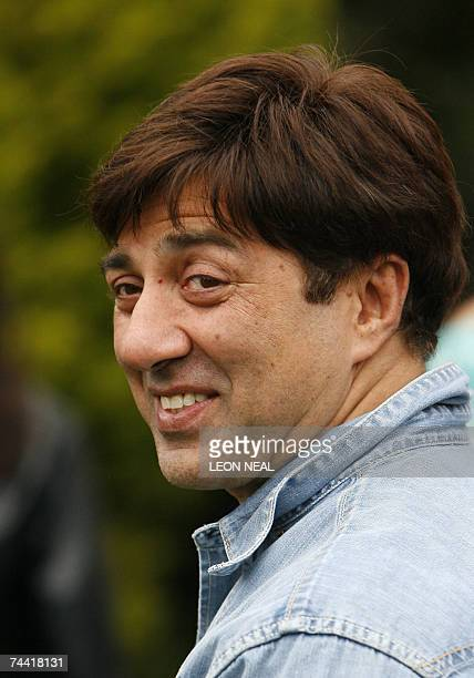 Indian film star Sunny Deol visits a family in Leeds 06 June 2007 as part of the promotion of the forthcoming film Apne during the International...