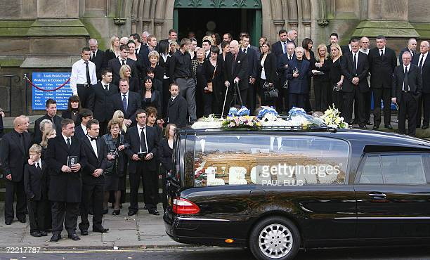 Mourners gather around the entrance to Leeds Parish Church in Leeds England 19 October 2006 after attending the funeral of British snooker player...