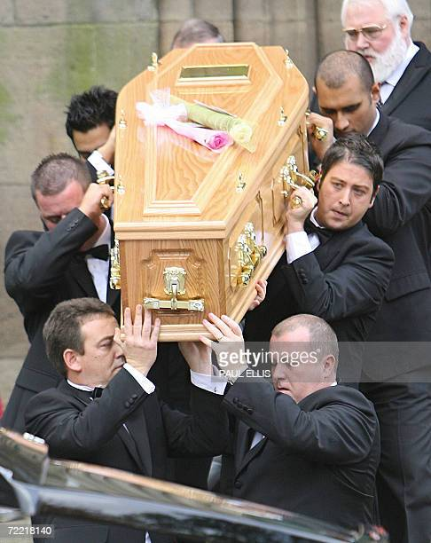 Leeds, UNITED KINGDOM: Pall bearers including snooker player Matthew Stevens carry the coffin containing the body of British snooker player Paul...