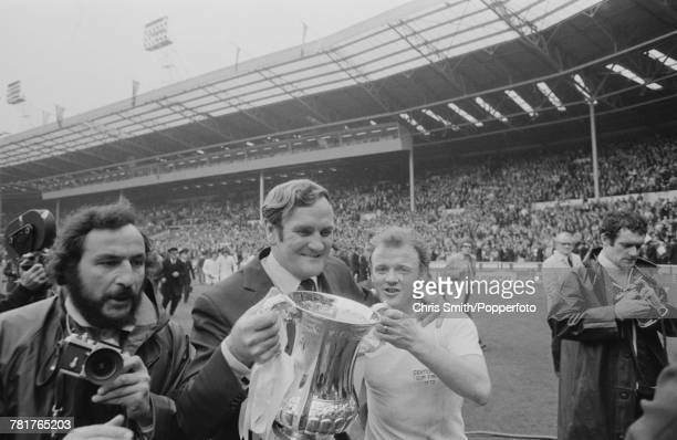 Leeds United manager Don Revie and captain Billy Bremner hold the trophy aloft after Leeds United beat Arsenal 10 to win the 1972 FA Cup Final at...