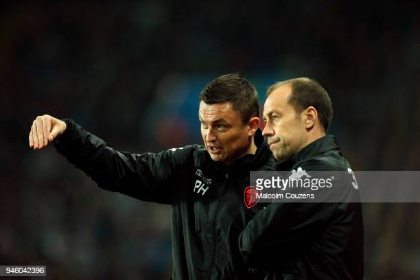 Leeds United manager Paul Heckingbottom and assistant Jamie Clapham look on during the Sky Bet Championship match between Aston Villa and Leeds...