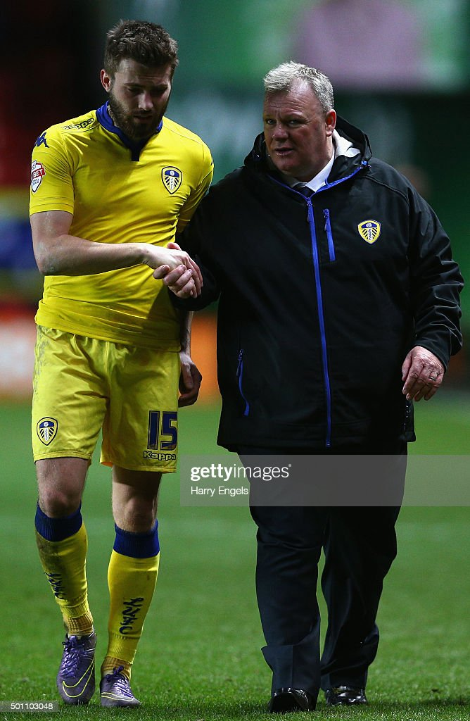 Leeds United manager Steve Evans (R) walks off the pitch with player Stuart Dallas at the end of the Sky Bet Championship match between Charlton Athletic and Leeds United at The Valley on December 12, 2015 in London, United Kingdom.