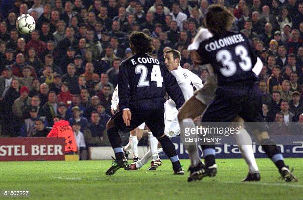 Leeds United midfielder Ian Bowyer scores Leeds first goal past Lazio's Fernando Couto and Francesco Colonnese 14 March 2001 during their EUFA group...