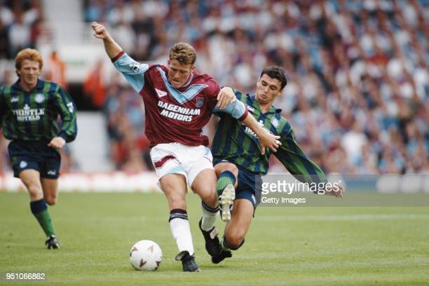 Leeds United player Gary Speed challenges West Ham United player Peter Butler as Gordon Strachan looks on during a Premier League game at Upton Park...