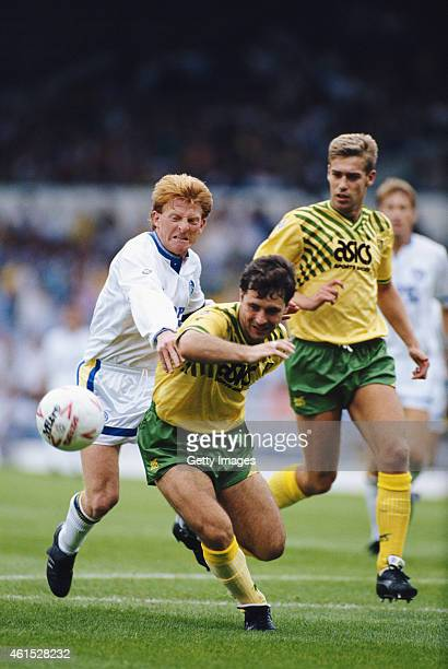 Leeds United player Gordon Strachan challenges Norwich defender Mark Bowen during a League Division One match on August 1 1990 in Leeds England