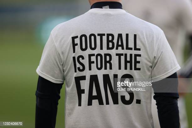 Leeds United player wears a T-shirt with a slogan against a proposed new European Super League during the warm up for the English Premier League...