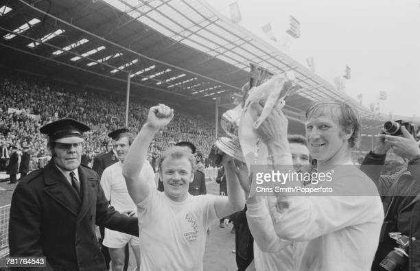 Leeds United players Billy Bremner and Jack Charlton hold the trophy aloft after Leeds United beat Arsenal 10 to win the 1972 FA Cup Final at Wembley...