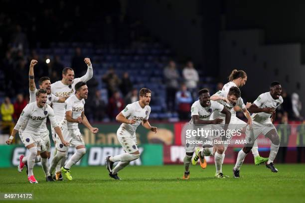 Leeds United players celebrate after winning the penalty shoot out during the Carabao Cup Third Round match between Burnley and Leeds United at Turf...