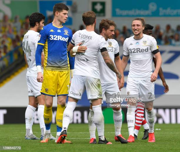 Leeds United players celebrate following the Sky Bet Championship match between Leeds United and Barnsley at Elland Road on July 16, 2020 in Leeds,...