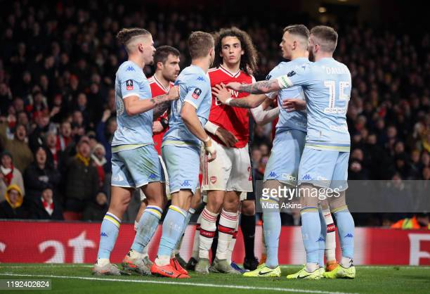 Leeds United players clash with Matteo Guendouzi of Arsenal during the FA Cup Third Round match between Arsenal and Leeds United at Emirates Stadium...