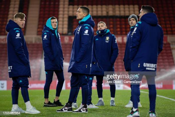 Leeds United players have a chat while inspecting the pitch at the Riverside Stadium during the Sky Bet Championship match between Middlesbrough and...
