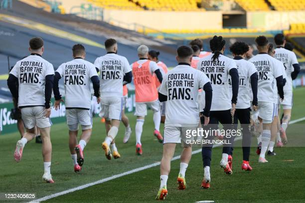 Leeds United players wear T-shirts with slogans against a proposed new European Super League during the warm up for the English Premier League...