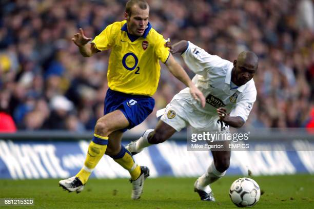 Leeds United Salomon Olembe and Arsenal's Fredrik Ljungberg battle for the ball