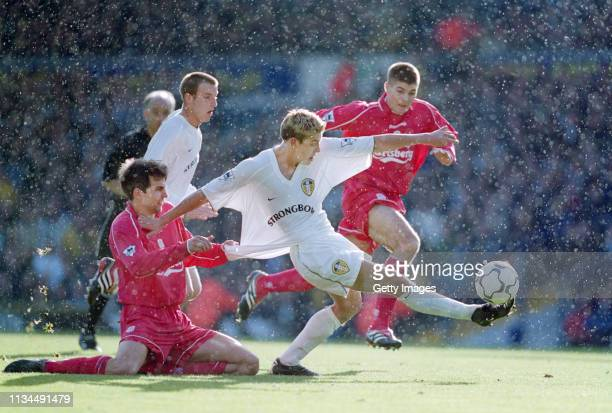 Leeds United striker Alan Smith gets in a shot at goal despite the shirt pulling attentions of Liverpool player Markus Babbel as a young Steven...