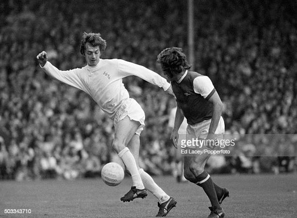 Leeds United striker Allan Clarke turns with the ball watched by Arsenal defender Bob McNab during their match at Highbury Stadium in London 11th...