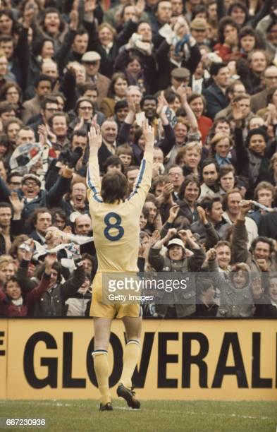 Leeds United striker Allan 'sniffer' Clarke applauds the Leeds United fans at a game circa 1974