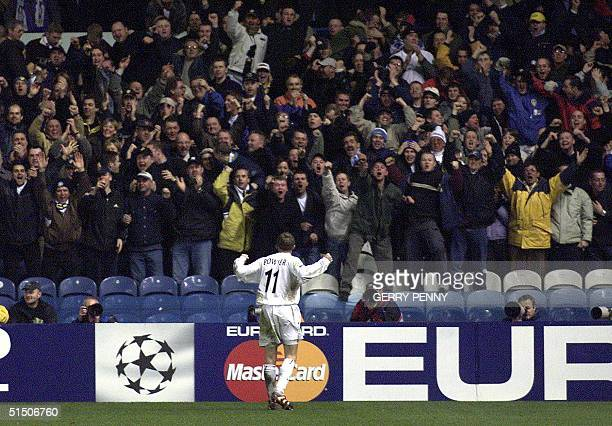 Leeds United striker Lee Bowyer celebrates his winning goal in front of fans 13 February 2001 during his teams 21 Champions League win against...
