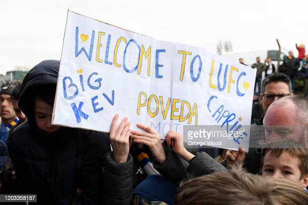 Leeds United supporter holds up a sign welcoming Ian Poveda and JeanKevin Augustin of Leeds United ahead of the Sky Bet Championship match between...