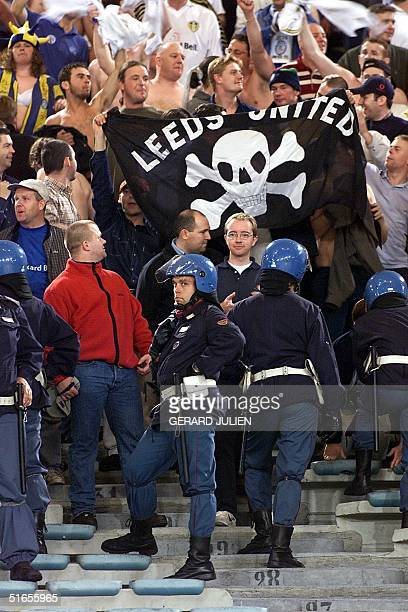 Leeds United supporters chant and wave banners in front of italian policemen during Leeds's second round first legf UEFA Cup match at Rome's Olympic...