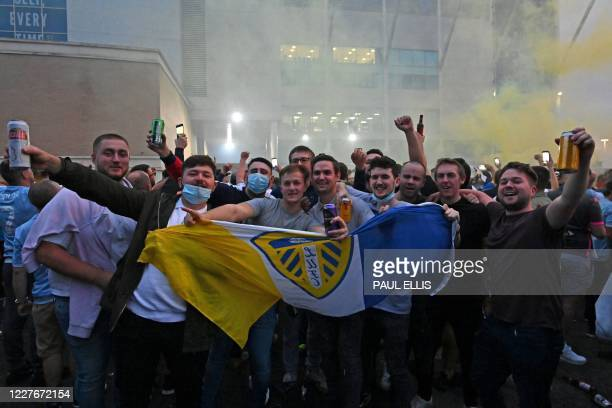 Leeds United supporters gather outside their Elland Road ground to celebrate the club's return to the Premier League after a gap of 16 years in Leeds...