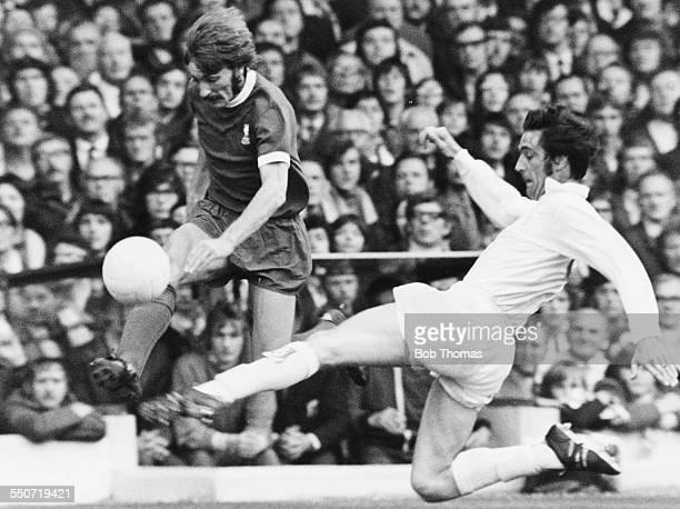 Leeds United vs Liverpool Norman Hunter of Leeds United tackles Liverpool striker Steve Heighway during the match at Elland Road in Leeds Yorkshire...