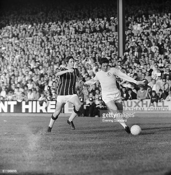 Leeds United winger Eddie Gray kicks the ball as Crystal Palace's Phil Hoadley runs to tackle 24th October 1969