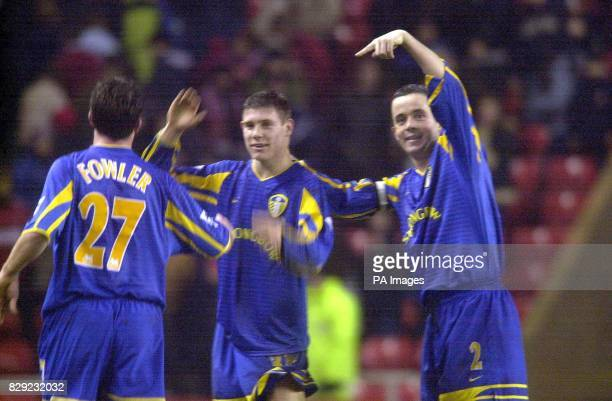 Leeds United's 16-year-old scorer James Milner who yesterday became the youngest player ever to chalk up a Premiership goal, with Robbie Fowler - who...
