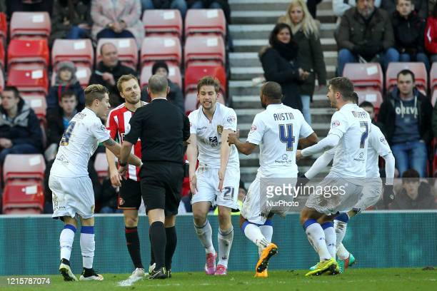 Leeds United's Adryan Oliveira Tavares, Charlie Taylor, Rodolph Austin and Luke Murphy surround referee, Mike Dean demanding a penalty during the FA...