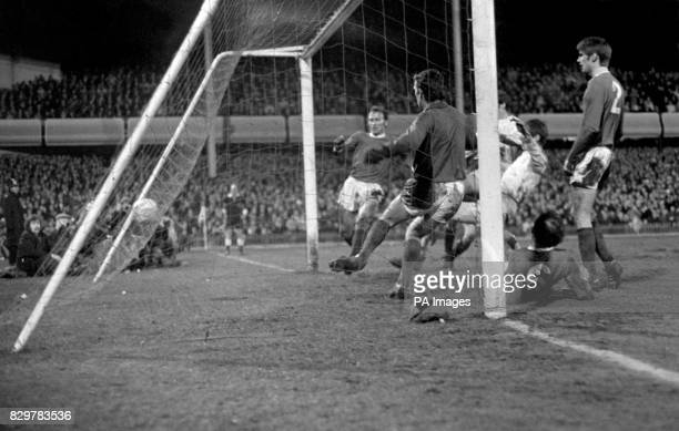 Leeds United's Allan Clarke pokes the ball past Manchester United goalkeeper Alex Stepney into the net but the referee had already blown for an...