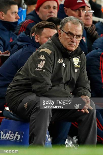 Leeds United's Argentinian head coach Marcelo Bielsa watches from his 'bucket' during the English FA Cup third round football match between Arsenal...
