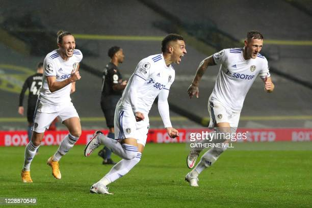 Leeds United's Brazilian-born Spanish striker Rodrigo celebrates after scoring their first goal during the English Premier League football match...