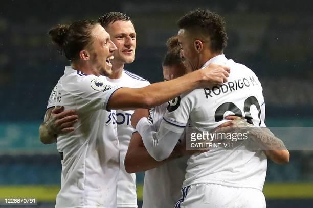 Leeds United's Brazilian-born Spanish striker Rodrigo celebrates with teammates after scoring their first goal during the English Premier League...