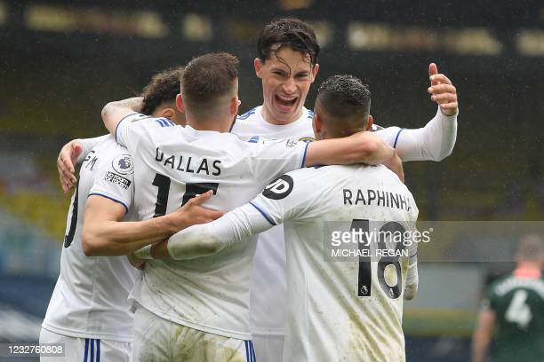 Leeds United's Brazilian-born Spanish striker Rodrigo celebrates with teammates after scoring his team's third goal during the English Premier League...