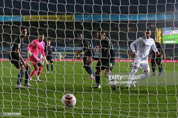 Leeds United's Brazilian-born Spanish striker Rodrigo watches his shot hit the City net as he scores their first goal during the English Premier...