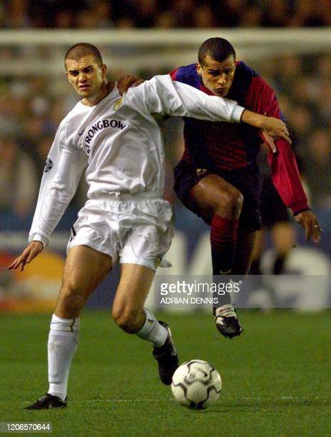 Leeds United's Dominic Matteo holds off Barcelona's Rivaldo during the first half of the Champions League match at Elland Road in Leeds 24 October...