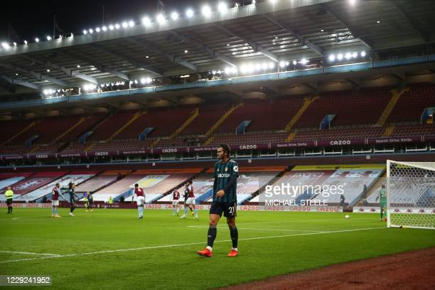 Leeds United's Dutch defender Pascal Struijk makes his way around the pitch after being substituted in the first half during the English Premier...