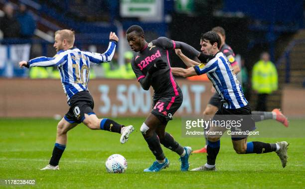 Leeds United's Edward Nketiah breaks away from Sheffield Wednesday's Barry Bannan and Kieran Lee during the Sky Bet Championship match between...